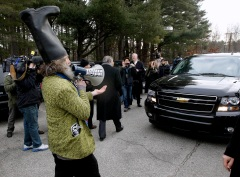 Vermin Supreme wearing a boot on his head